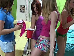 A group of cute girls striping on camera
